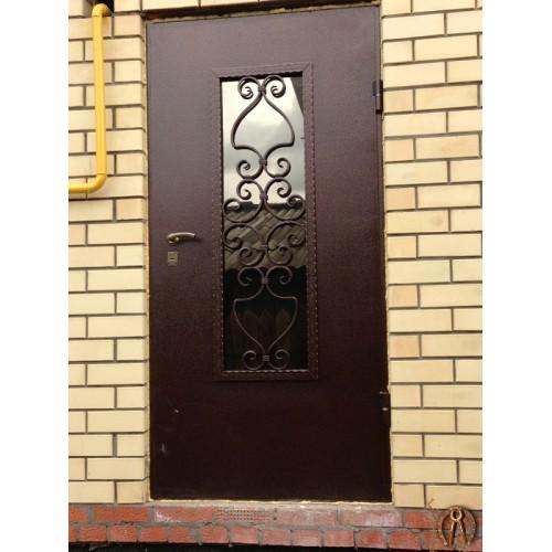 Стальная дверь с ковкой 2